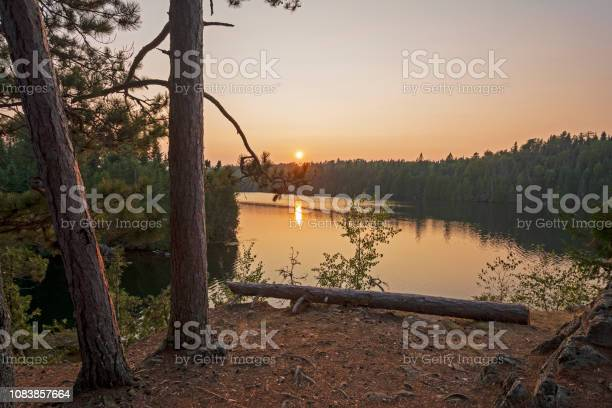 Photo of The Sun setting on the North Woods
