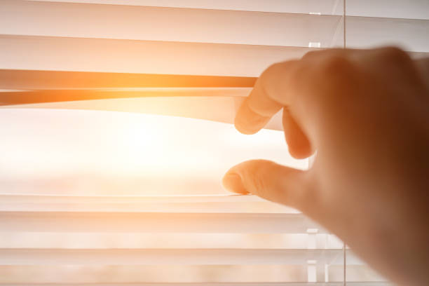 The sun shines through the blinds. stock photo