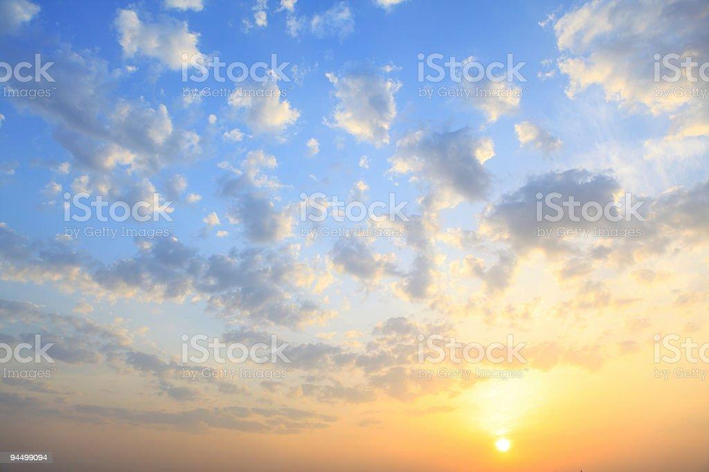 the sun shining through low cloud stock photo