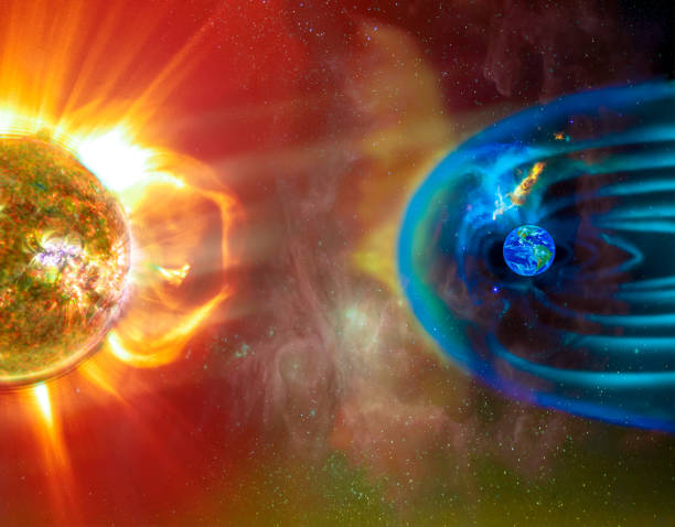 The Sun-Earth connection space weather. Blasts of perticles and magnetic field from the sun impact magnetosphere. Magnetic bubble around the Earth. Elements of this image furnished by NASA. stock photo