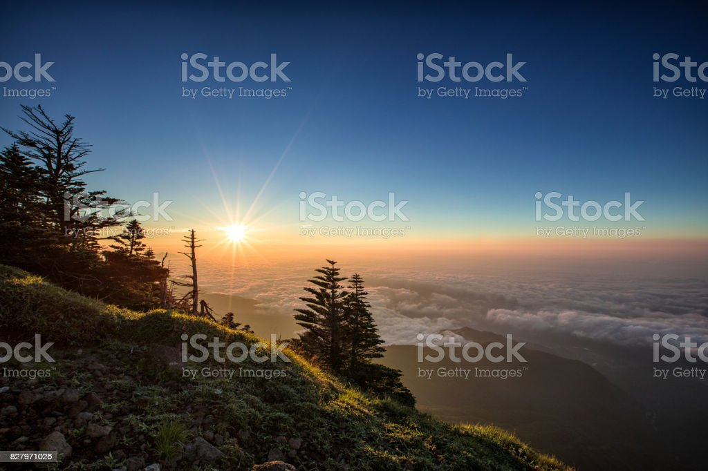 The sunrise above the clouds stock photo