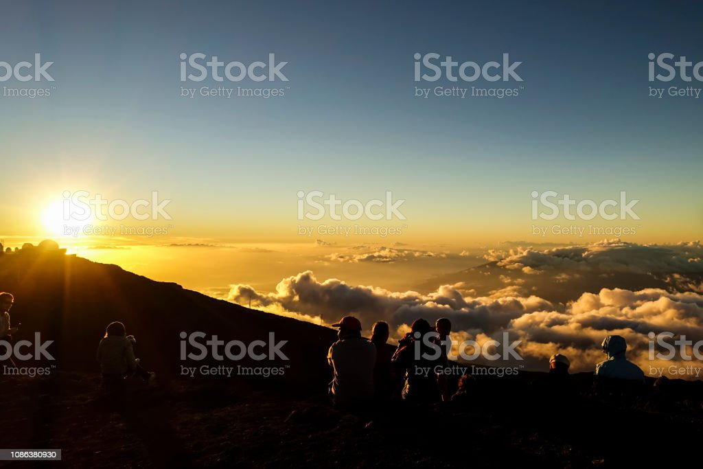 the sunset at the top of the Haleakala, MAUI, HAWAII stock photo