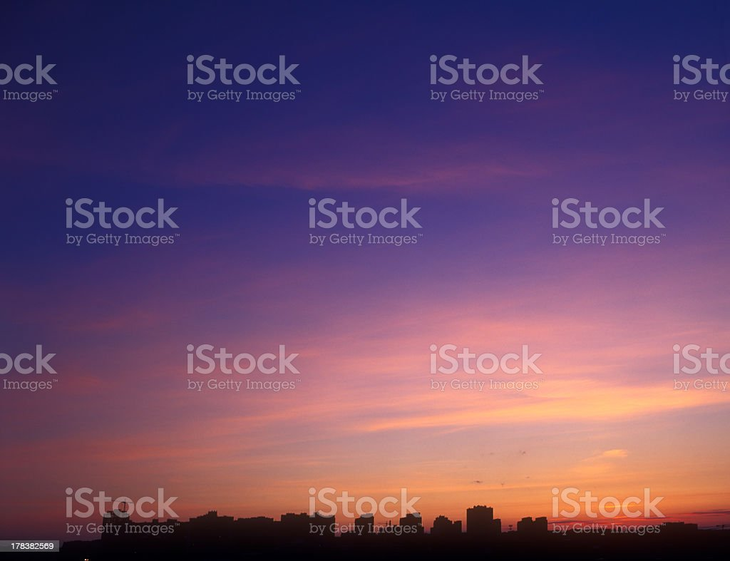 The sunset in different hues of purple stock photo