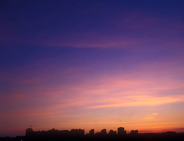 The sunset in different hues of purple Beautiful multicolored sunset over a dark cityscape. You can find my other similar photos here dusk stock pictures, royalty-free photos & images