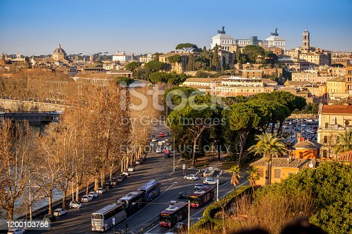 Rome, Ital; January 15 -- The warm light of sunset illuminates the area of the Campidoglio (Roman Capitol Hill), the Altare della Patria (Vittoriano) and the Lungotevere (river side street), in the historic heart of the Eternal City, in a panoramic photo taken from the Aventine hill. HD format image.