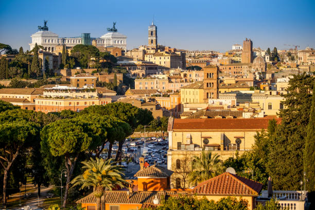 The sunset light illuminates the Capitol Hill and the Vittoriano in Rome stock photo