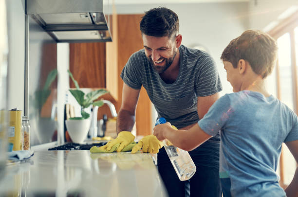 the super disinfecting son and dad duo - lysol stock pictures, royalty-free photos & images