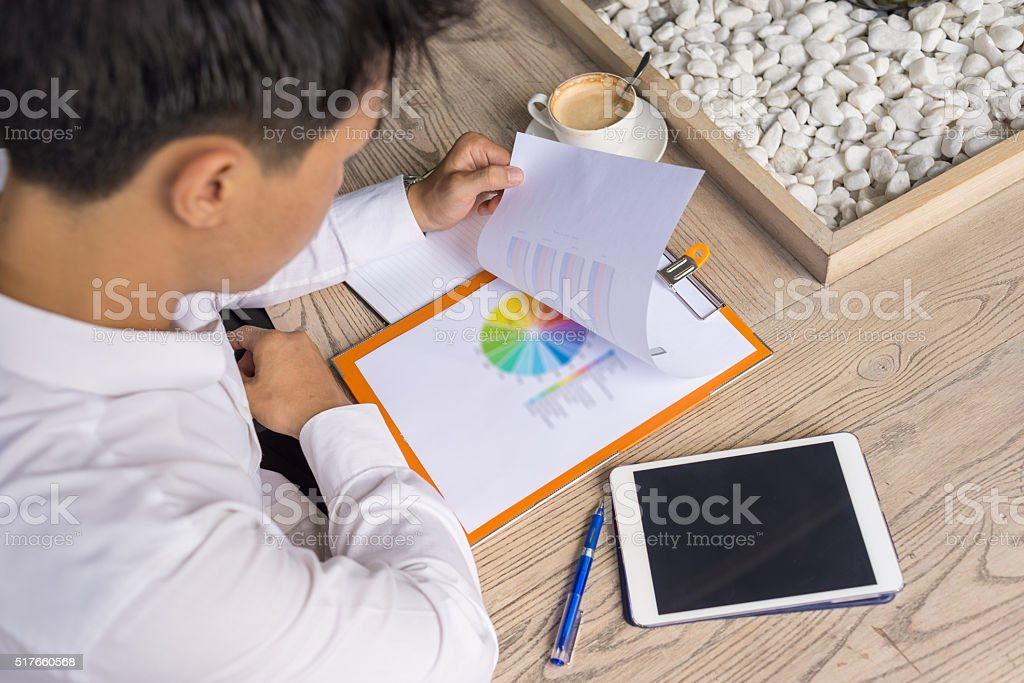 The supervisor revising some unclear points of report stock photo