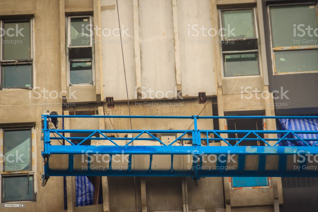 The suspended cradle for exterior work in hi-rise building...