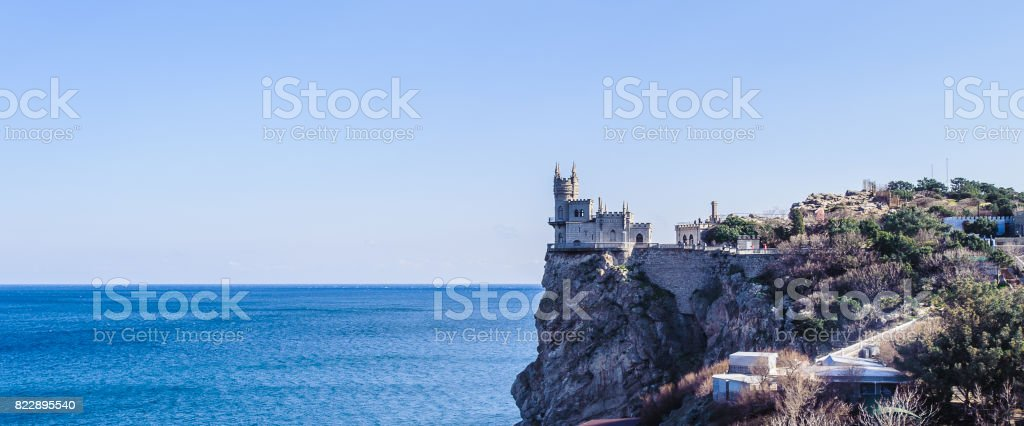 The Swallow's Nest, a decorative castle located between Yalta and Alupka on the Crimean peninsula in southern Ukraine. It was built between 1911 and 1912 in Gaspra, on top of 40-metre high Aurora Cliff, to a Neo-Gothic design stock photo
