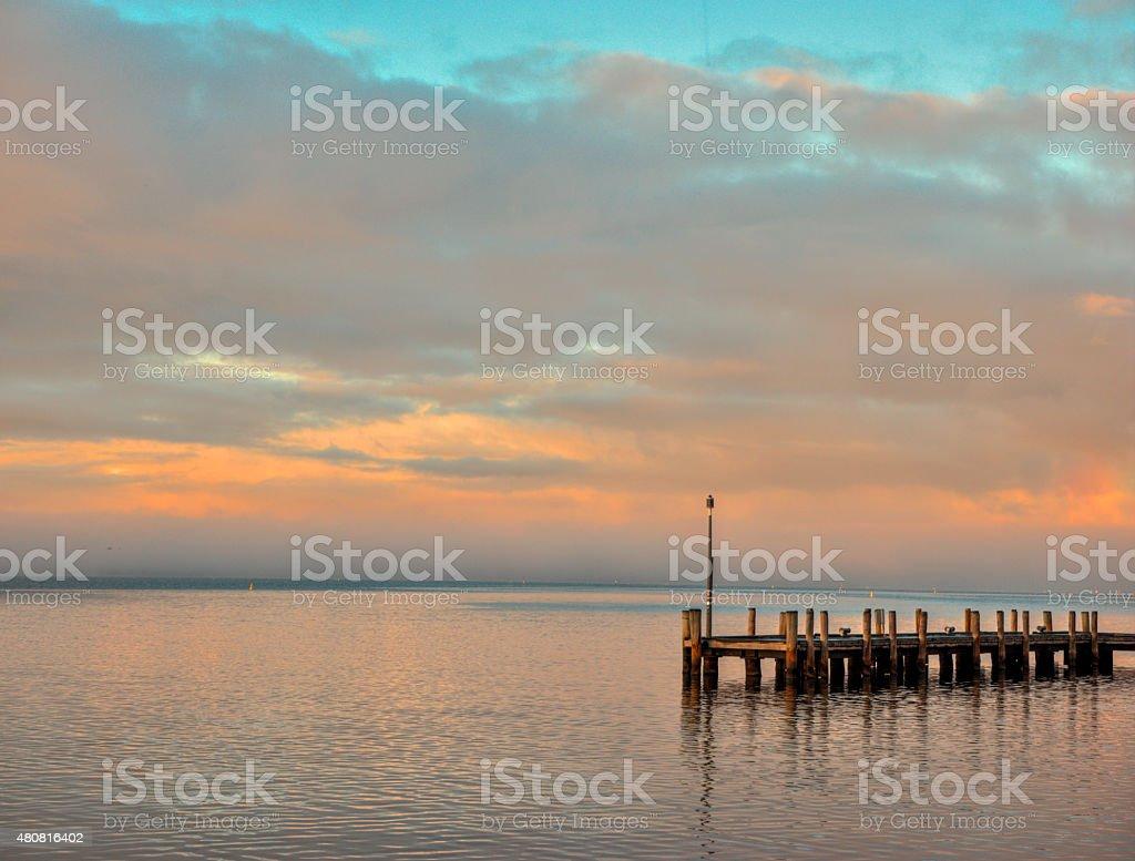 The Swan River Perth Western Australia calm at dawn jetty stock photo