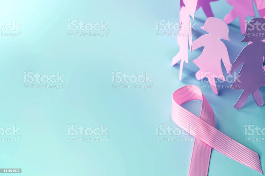 The Sweet pink ribbon shape with girl paper doll on blue background  for Breast Cancer Awareness symbol to promote  in october month campaign stock photo