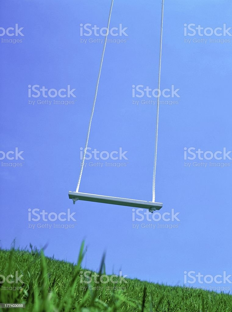 The swing which shakes on a spring breeze royalty-free stock photo