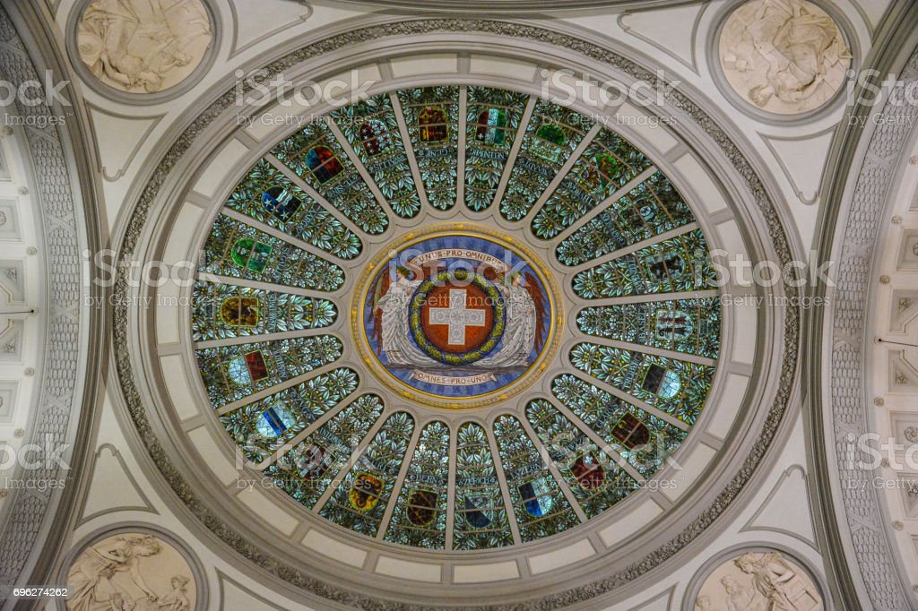 The Swiss Flag and emblems of all cantons of Switzerland on the ceiling in the 'Bundeshaus' in Bern stock photo