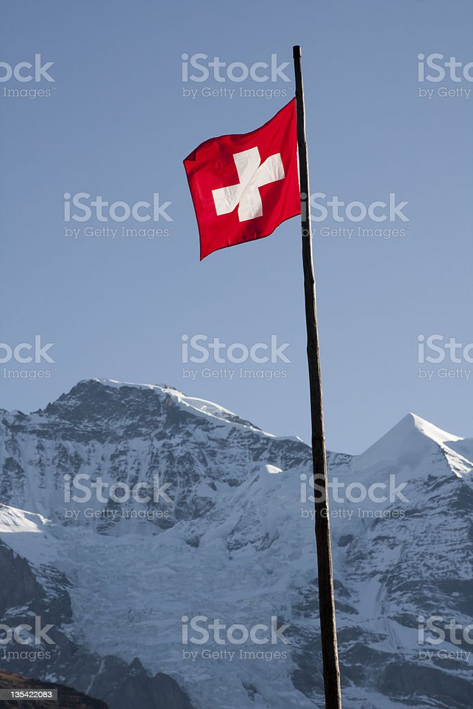 The Swiss Flag with Snow Capped Peak royalty-free stock photo