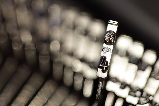The @ symbol on a typewriter stock photo