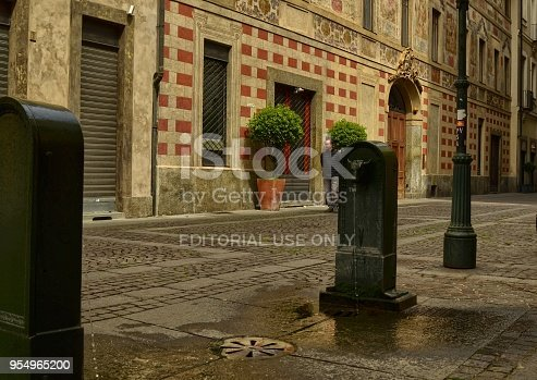 Turin, Piedmont region, Italy. May 2018. The symbolic fountain of Turin, the torello or turet in Piedmontese. They are found in every corner of the city, almost always colored green, sometimes gray.