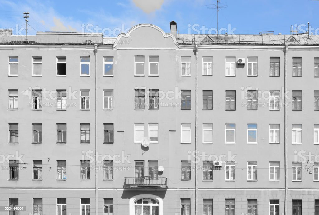 The symmetrical building with a balcony, a selection of blue stock photo