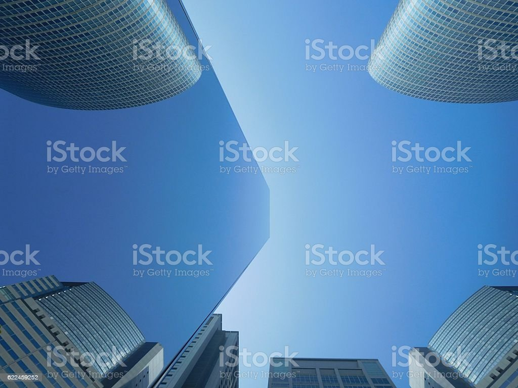 The symmetry of the office building in the mirror stock photo