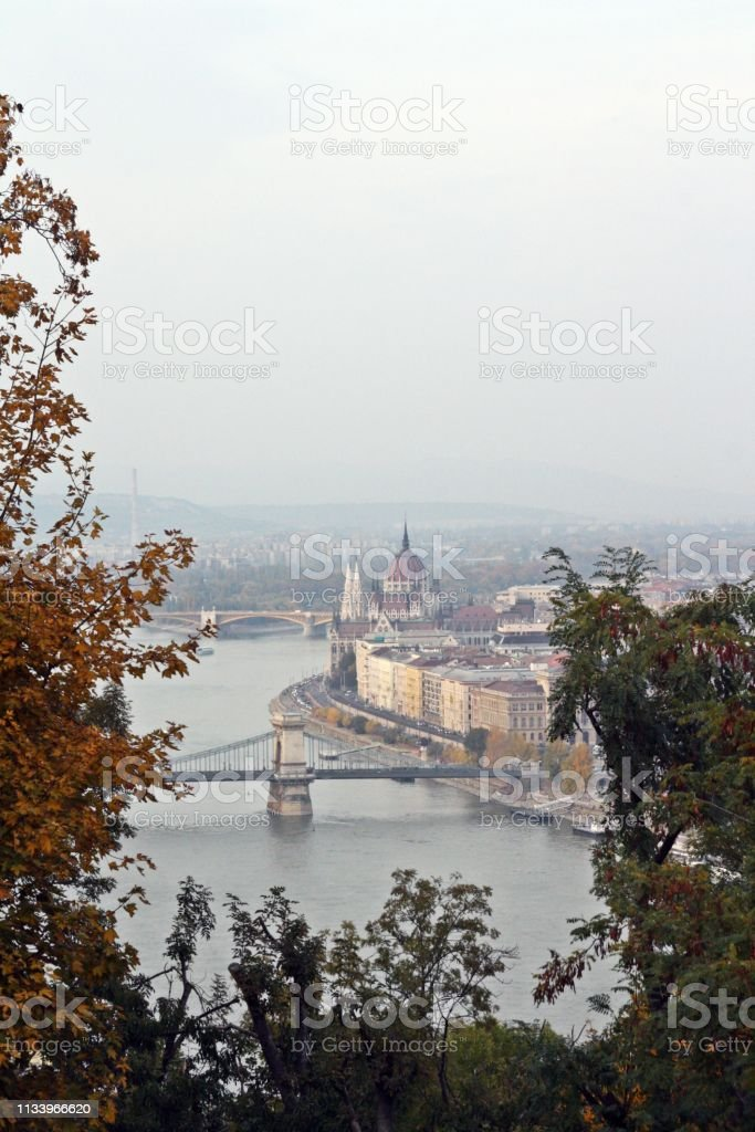 The Széchenyi Chain Bridge among trees in Budapest. stock photo