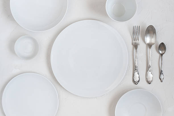 The table with empty white plates stock photo