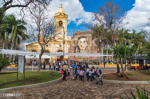 Villarrica, Paraguay - September 17, 2018: The tableau of the well-known Paraguayan artist Delfin Roque Ruiz (Koki Ruiz) in Villarrica, representing Chiquitunga, beatified in Asunción earlier this year. The tableau consists of thousands of rosaries. School classes in the foreground visit the exhibition.