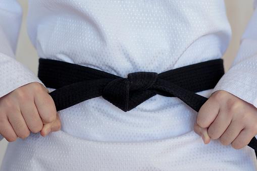 istock The taekwondo girl with black belt 898963760