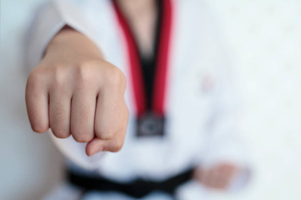 The taekwondo girl with black belt stock photo