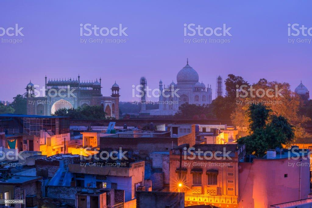 The Taj Mahal and Agra town at dawn stock photo