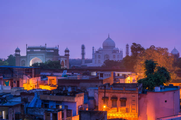 the taj mahal and agra town at dawn - india stock pictures, royalty-free photos & images