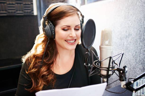 the talent behind an informative radio talk show - talk in a radio foto e immagini stock