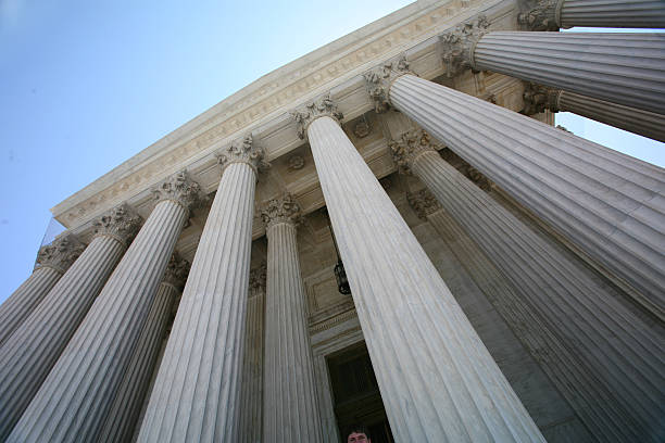 The tall pillars of the US Supreme Court building stock photo