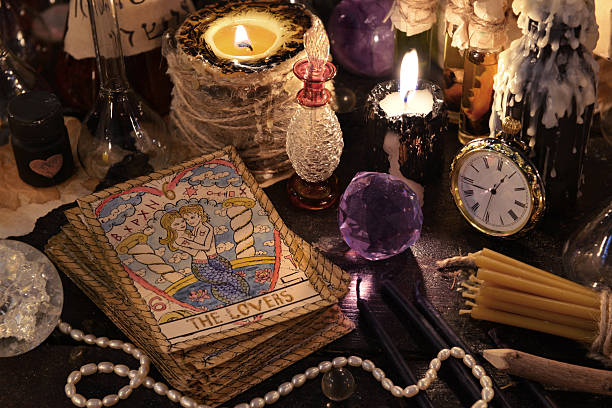 the tarot cards with crystal, candles and magic objects - sezme stok fotoğraflar ve resimler