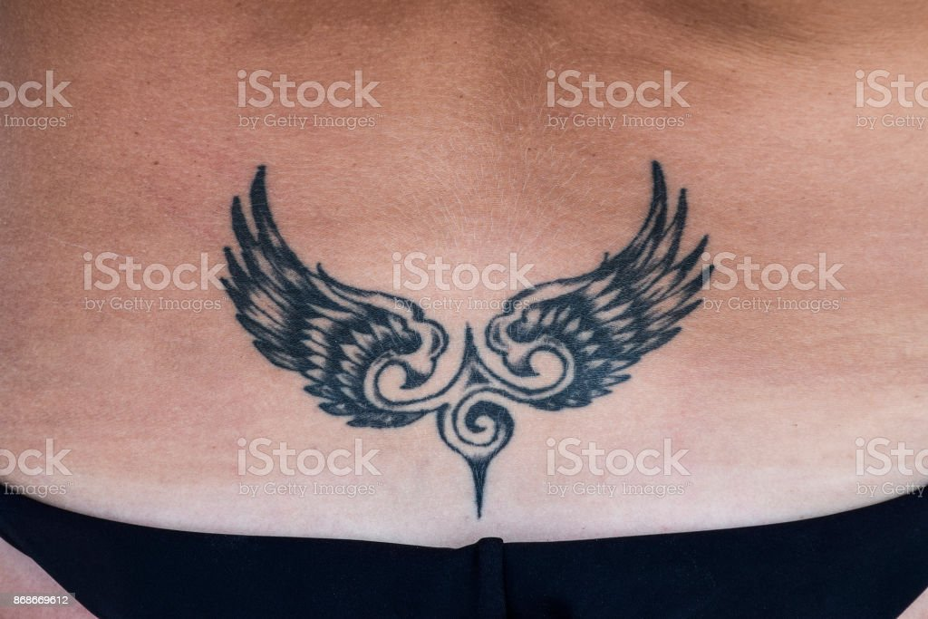 The Tattoo In The Shape Of Wings On The Back Stock Photo More