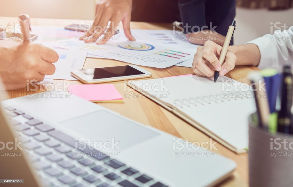 The team that helps brainstorm work. To achieve the goal, Concept teamwork that has the technology to make it faster. stock photo