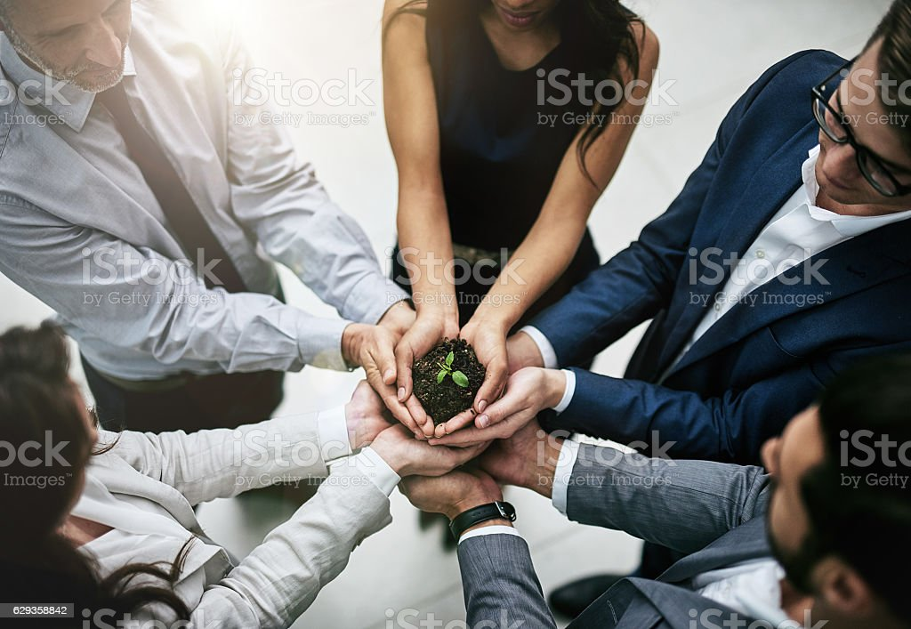 The team that works together grows together stock photo