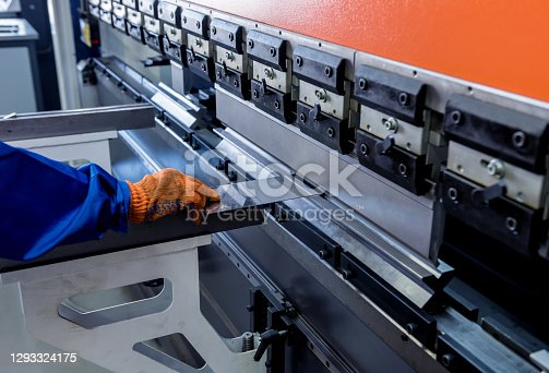 The technician operator use hydraulic bending machine