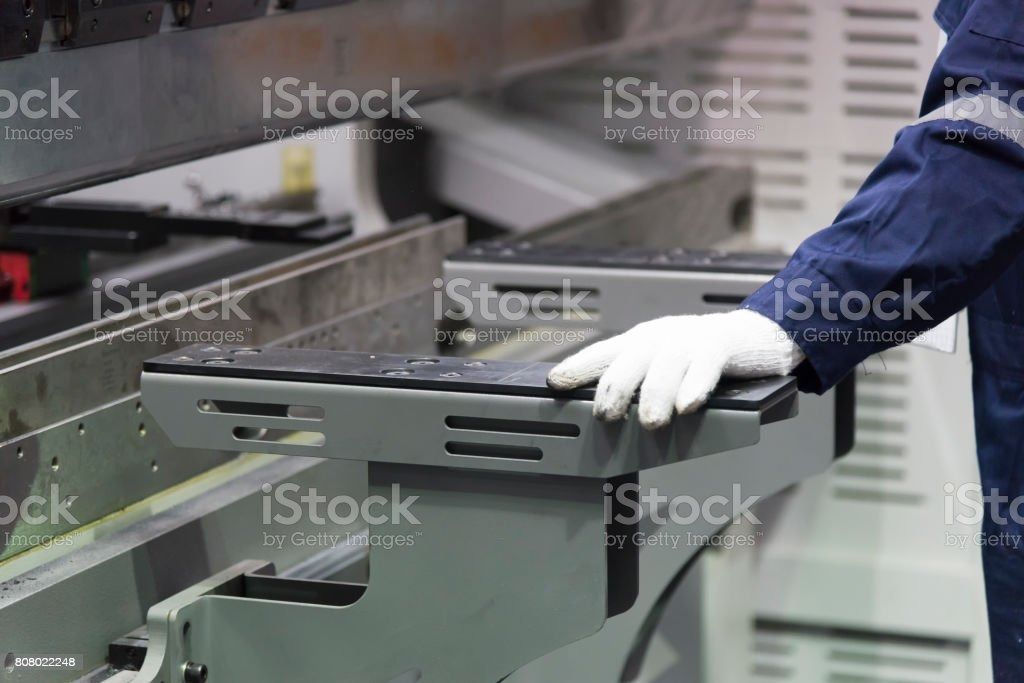 The technician operator use hydraulic bending stock photo