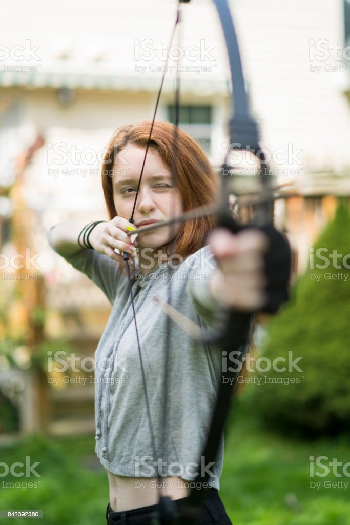 The teenager girl practicing archery stock photo