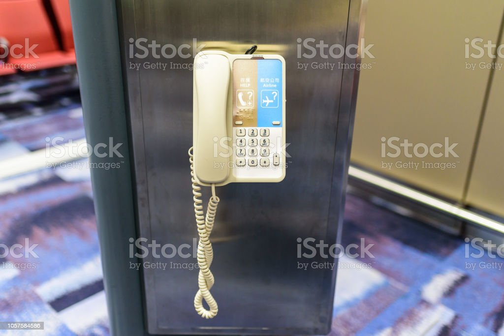 The telephone was hanging on a pole in the airport. Used for help or...