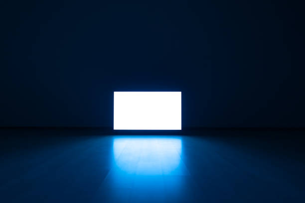 The television on a floor with a blue light background The television on a floor with a blue light background the bigger picture stock pictures, royalty-free photos & images