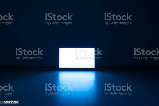 Photo of The television on a floor with a blue light background