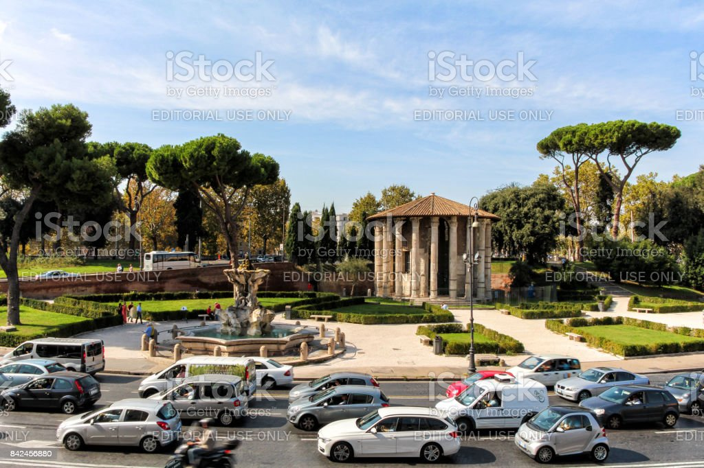 The temple of Hercules the winner, the Triton fountain in the square 'Mouth of truth' in Rome stock photo