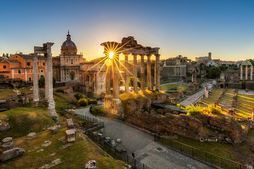 The Temple of Saturn by sunrise at Roman Forum, Rome