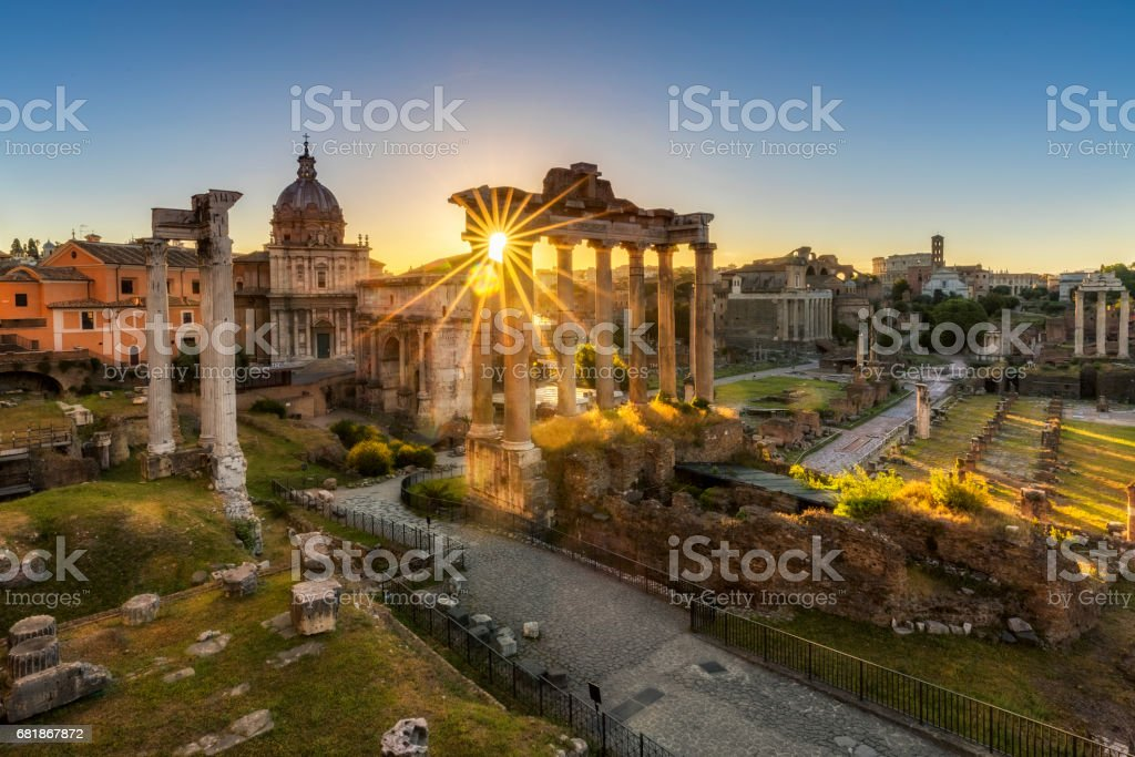 The Temple of Saturn by sunrise at Roman Forum, Rome stock photo