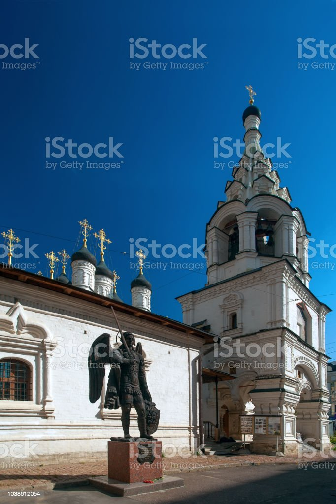 The temple of the Icon of the Mother of God Sign for Peter gate with Saint Michael archangel full body sculpture. Moscow stock photo