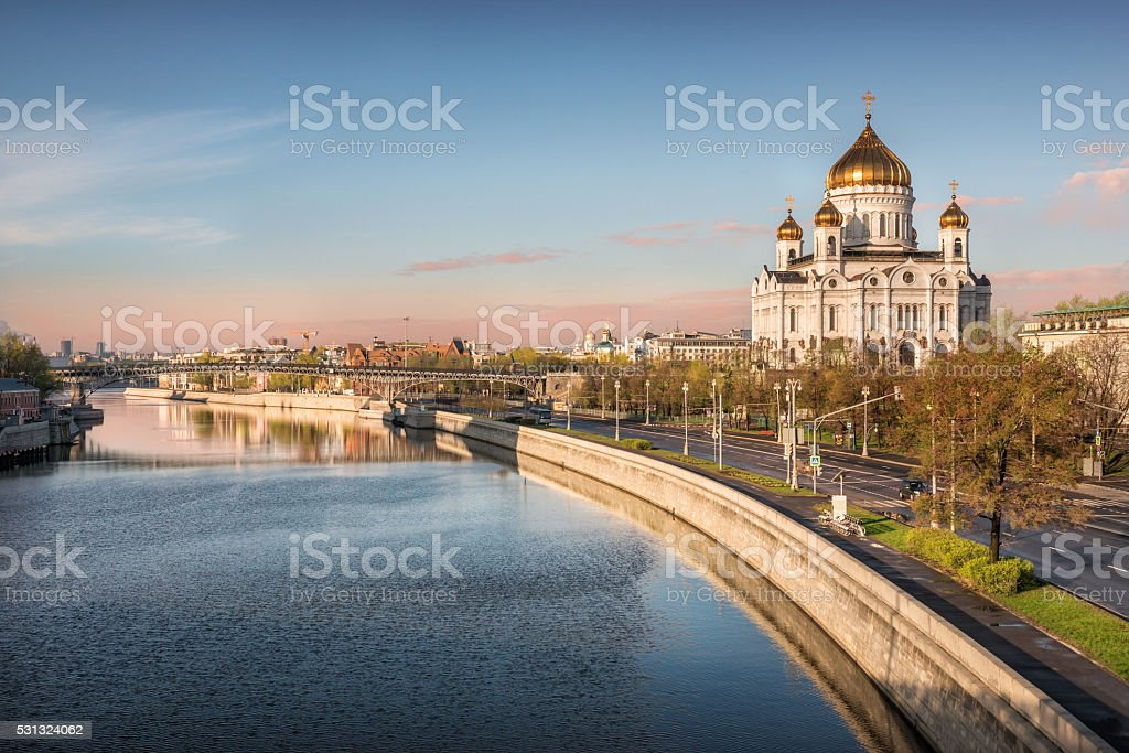 The temple on the river in the city stock photo