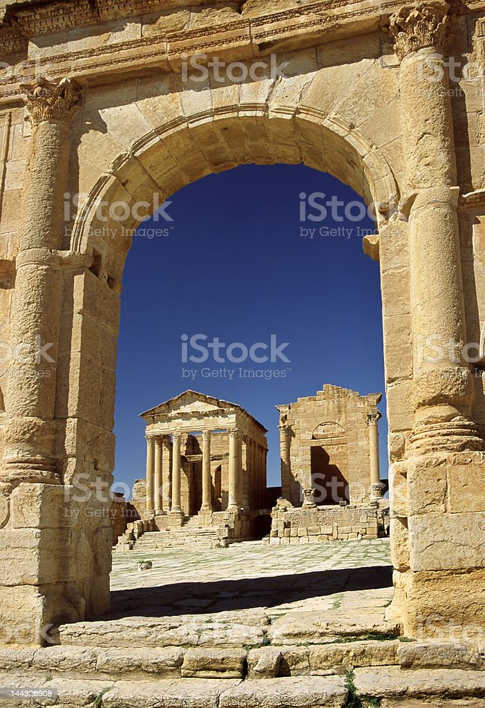 The temples seen from arch in Sufetula royalty-free stock photo