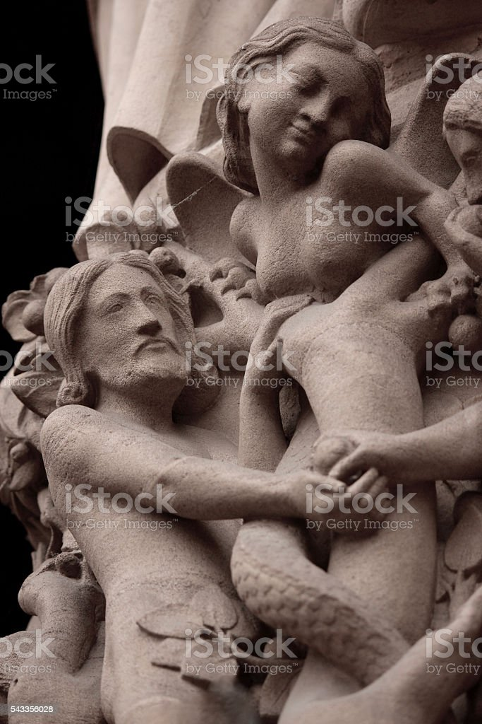 The Temptation of Adam and Eve - Notre Dame Cathedral stock photo