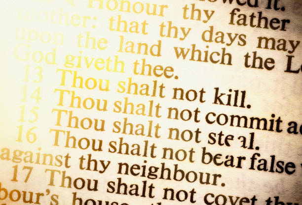 The Ten Commandments, brightly lit, in old Bible stock photo